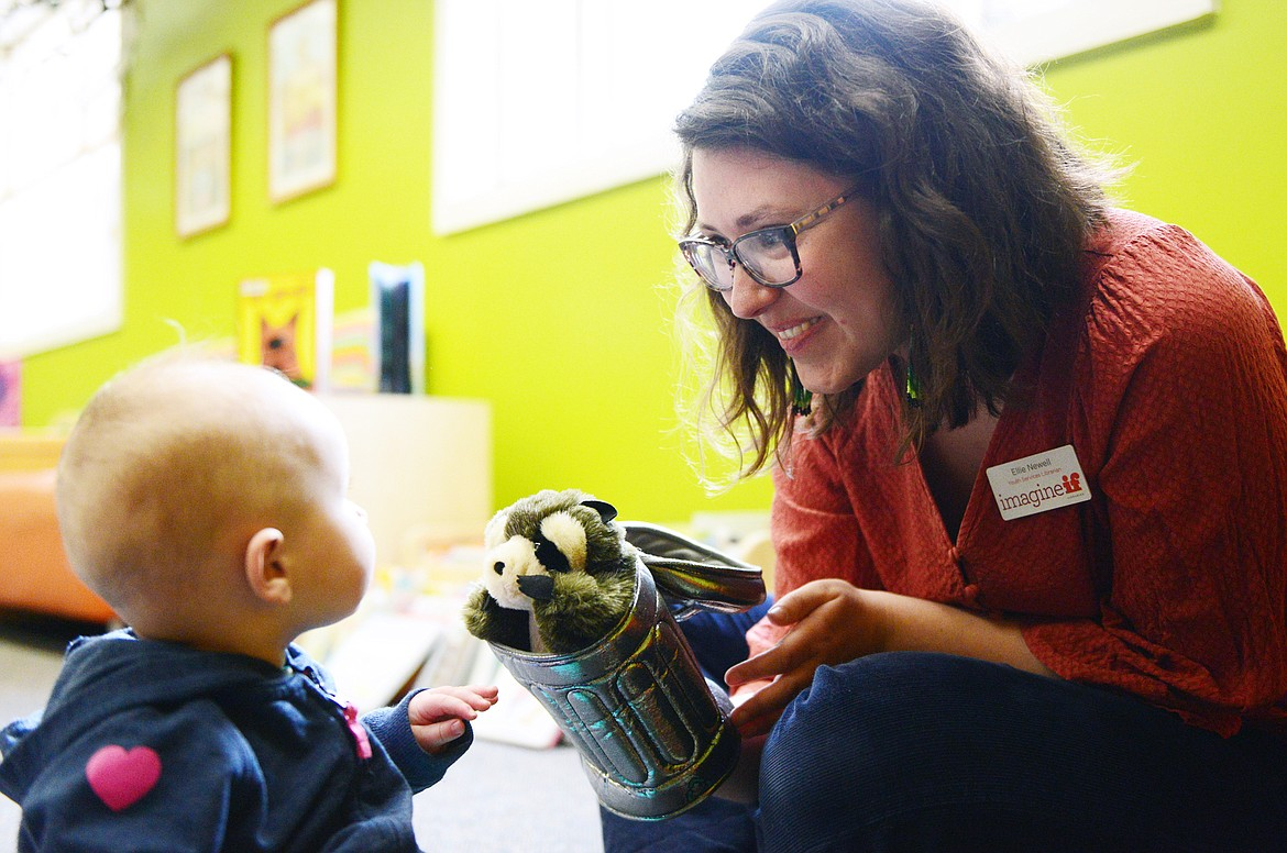 Ellie Newell, Youth Services Librarian at ImagineIF Library Kalispell, entertains a young visitor with a puppet on Friday, March 6. (Casey Kreider/Daily Inter Lake)