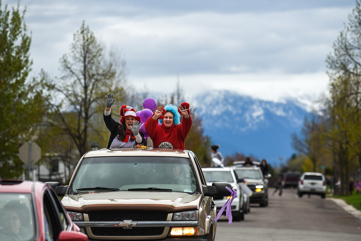 Rankin Elementary School teachers and staff parade through the neighborhood along Bluestone Drive in Kalispell on Thursday, May 7. (Casey Kreider/Daily Inter Lake)
