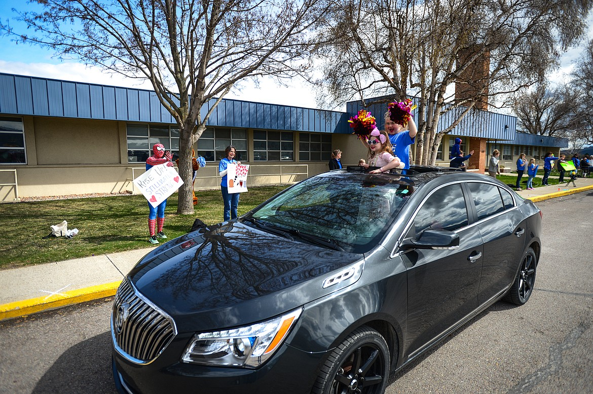 Students and parents wave to Stillwater Christian School staff members during a parade for grades K-5 outside the school on Friday, April 24. (Casey Kreider/Daily Inter Lake)
