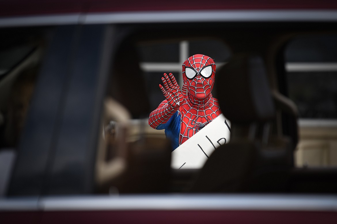 Stillwater Christian School second-grade teacher Jasmine Chase waves to students and parents while wearing a Spiderman costume during a parade for K-5 students and teachers outside the school on Friday, April 24. (Casey Kreider/Daily Inter Lake)