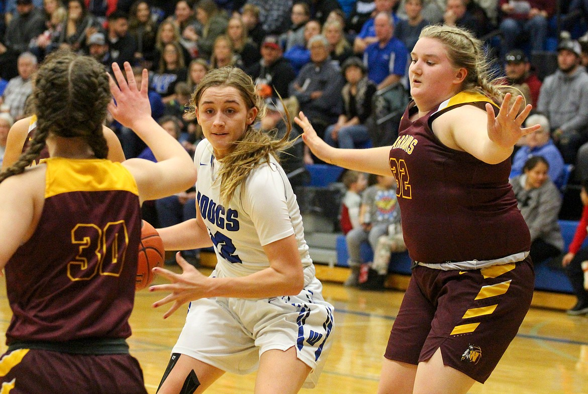 Casey McCarthy/Columbia Basin Herald Senior Brecka Erdmann cuts into the lane before stepping back for the floater in the fourth quarter of Warden's 64-32 win to open up its postseason.