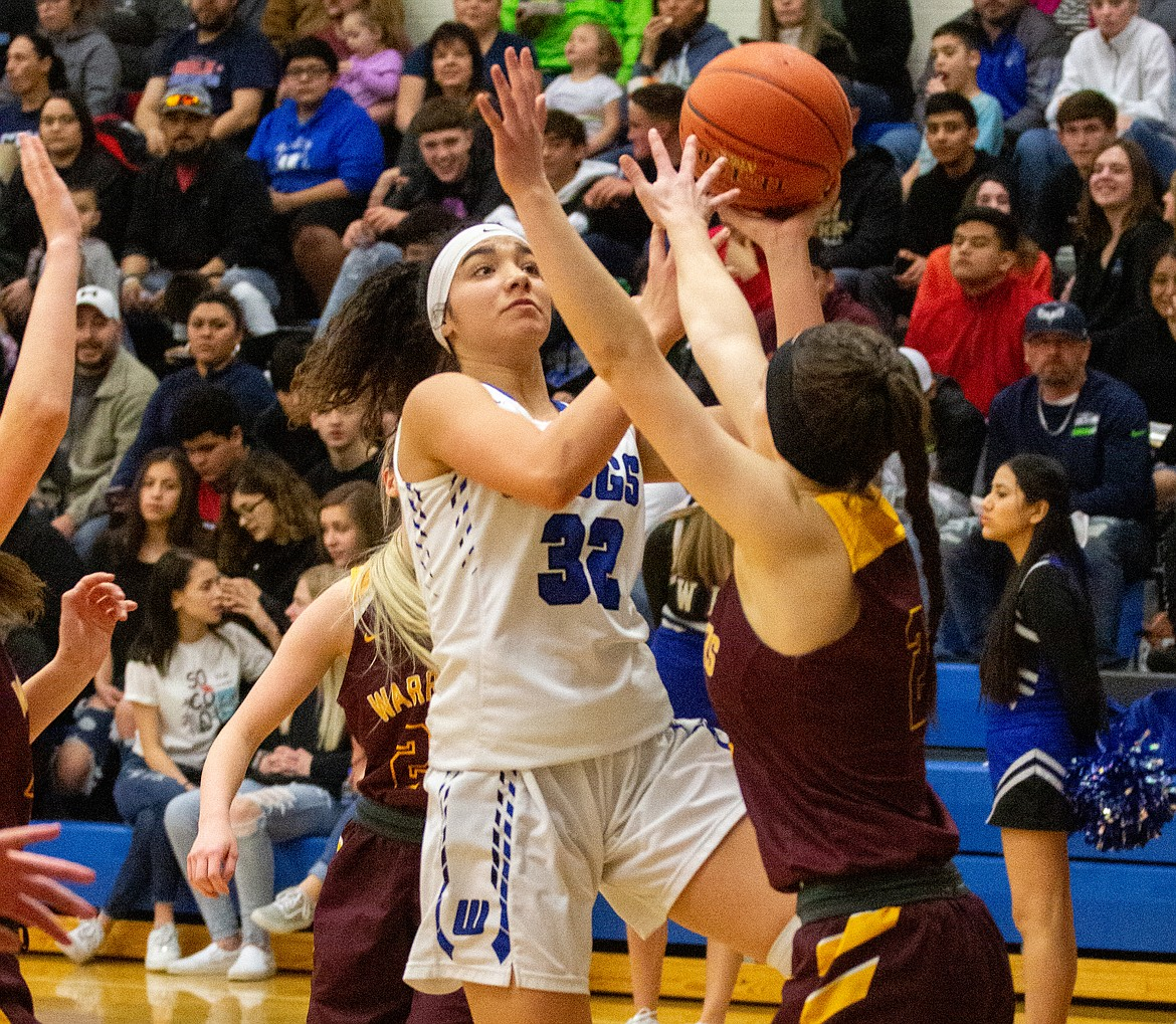 Sophomore Kiana Rios cuts through traffic for the layup in the second half on Thursday night. Rios led the Cougars with 18 points in the win.