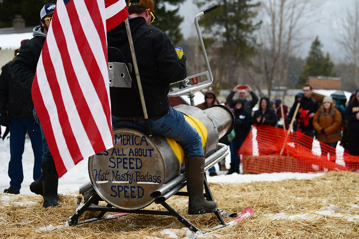Participants cross the finish line after racing down Sugar Hill during the Barstool Ski Races at Cabin Fever Days in Martin City on Saturday, Feb. 15. (Casey Kreider/Daily Inter Lake)