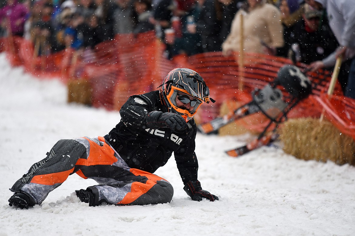 A racer crashes riding down Sugar Hill during the Barstool Ski Races at Cabin Fever Days in Martin City on Saturday, Feb. 15. (Casey Kreider/Daily Inter Lake)