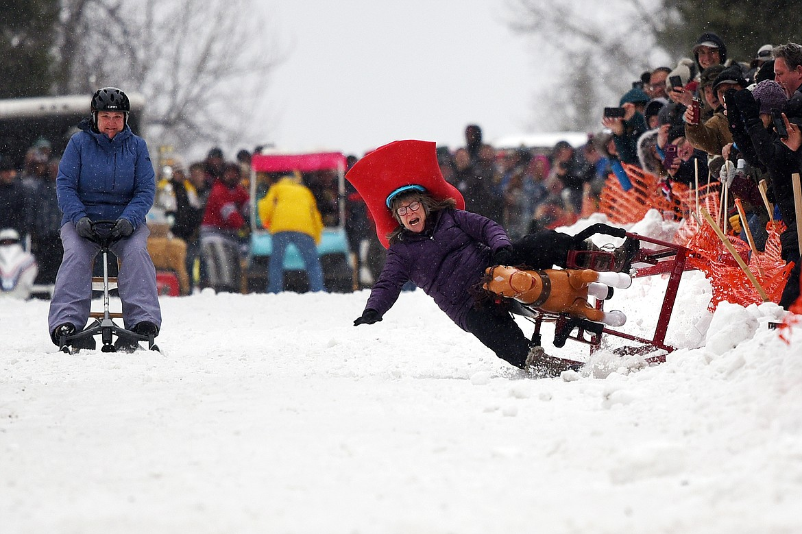 A participant crashes as they race down Sugar Hill during the Barstool Ski Races at Cabin Fever Days in Martin City on Saturday, Feb. 15. (Casey Kreider/Daily Inter Lake)