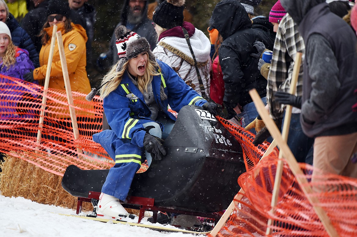 A participant crashes racing down Sugar Hill during the Barstool Ski Races at Cabin Fever Days in Martin City on Saturday, Feb. 15. (Casey Kreider/Daily Inter Lake)