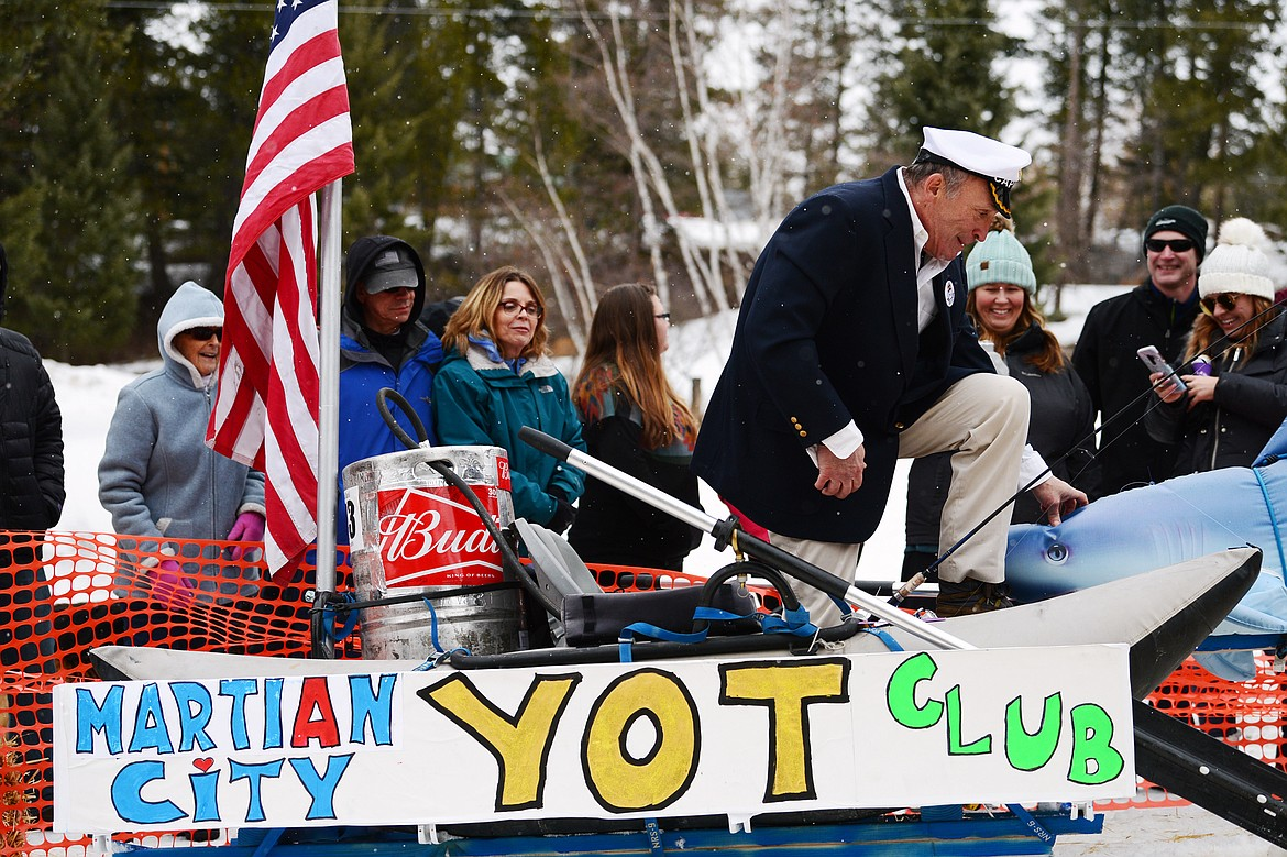 Mike Murray steps out of his racer after crossing the finish line at the Barstool Ski Races at Cabin Fever Days in Martin City on Saturday, Feb. 15. (Casey Kreider/Daily Inter Lake)