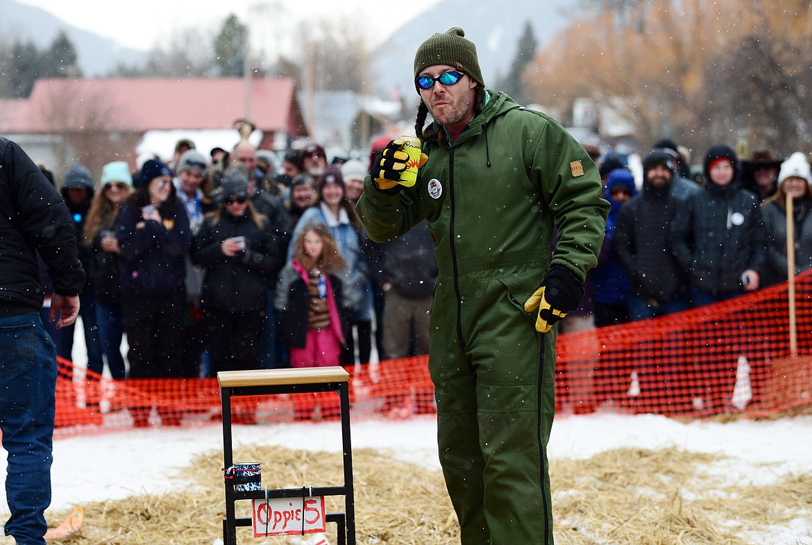 A racer sips his beverage after crossing the finish line at the Barstool Ski Races at Cabin Fever Days in Martin City on Saturday, Feb. 15. (Casey Kreider/Daily Inter Lake)