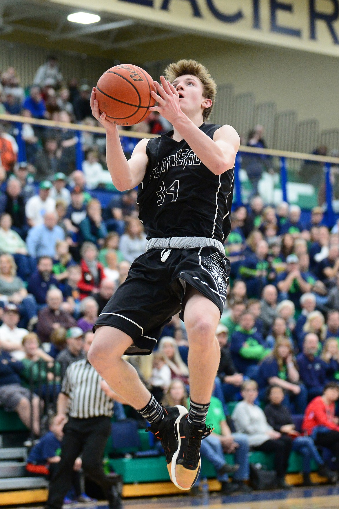 Flathead's Joston Cripe (34) goes to the hoop against Glacier during a crosstown matchup at Glacier High School on Friday. (Casey Kreider/Daily Inter Lake)