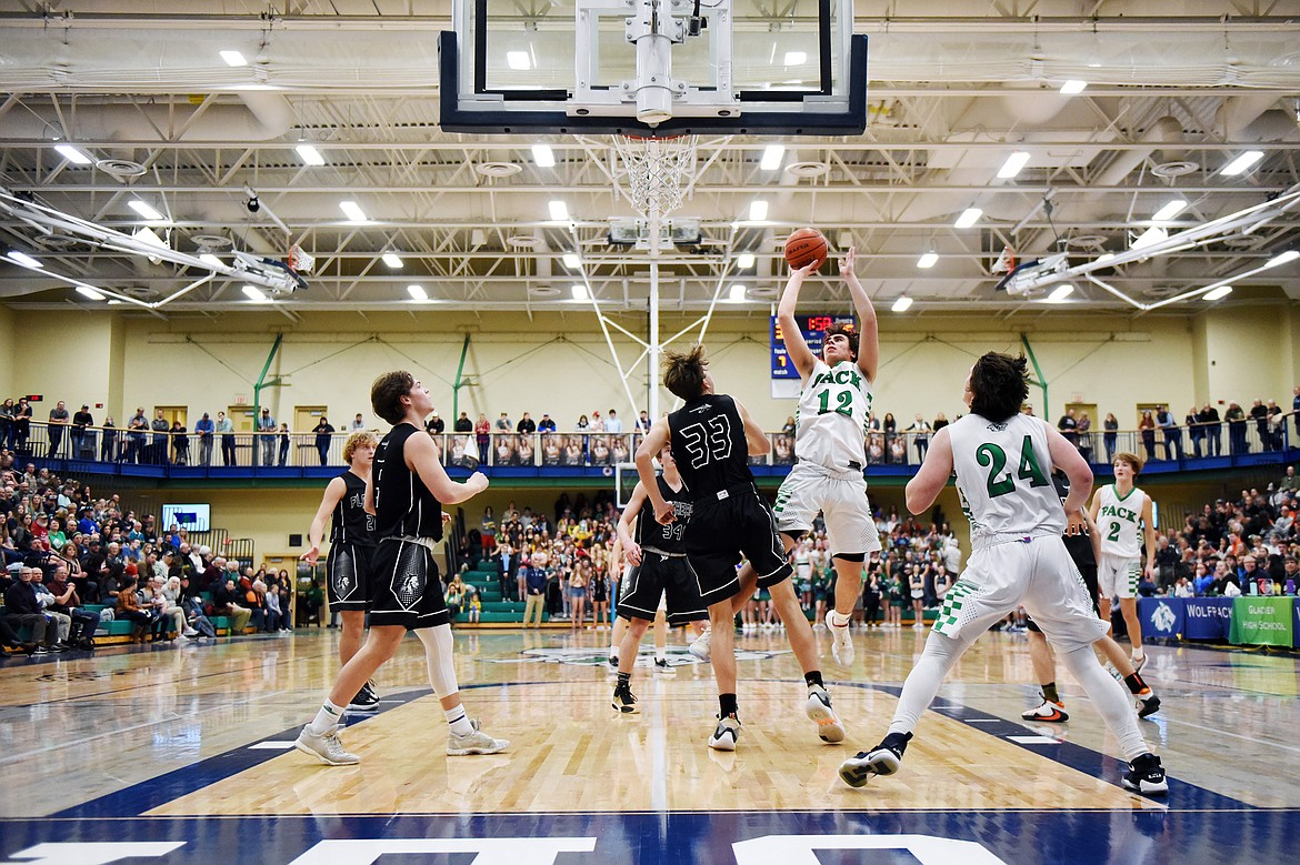 Glacier's Weston Price (12) looks to shoot against Flathead during a crosstown matchup at Glacier High School on Friday. (Casey Kreider/Daily Inter Lake)