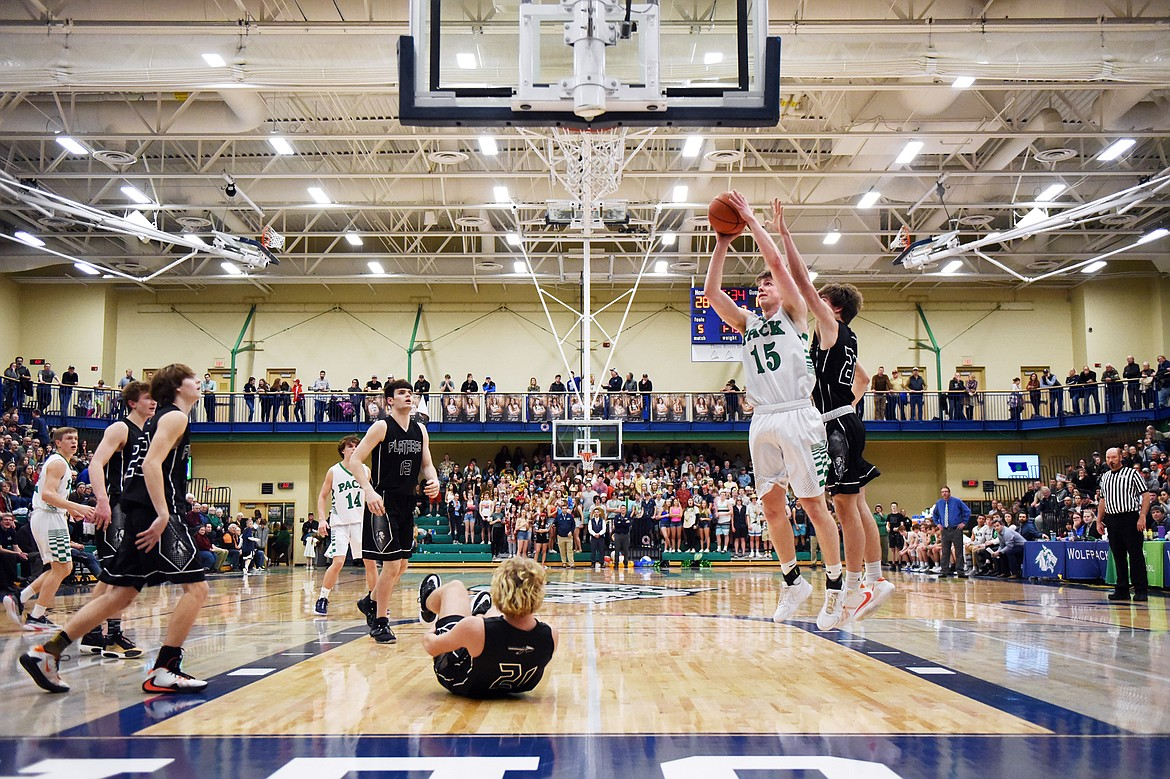 Glacier's Drew Engellant (15) looks to shoot against Flathead during a crosstown matchup at Glacier High School on Friday. (Casey Kreider/Daily Inter Lake)