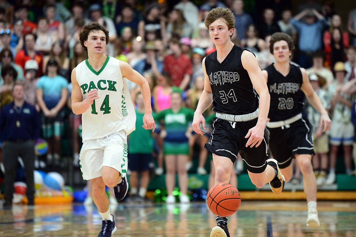 Flathead's Joston Cripe (34) brings the ball upcourt against Glacier during a crosstown matchup at Glacier High School on Friday. (Casey Kreider/Daily Inter Lake)