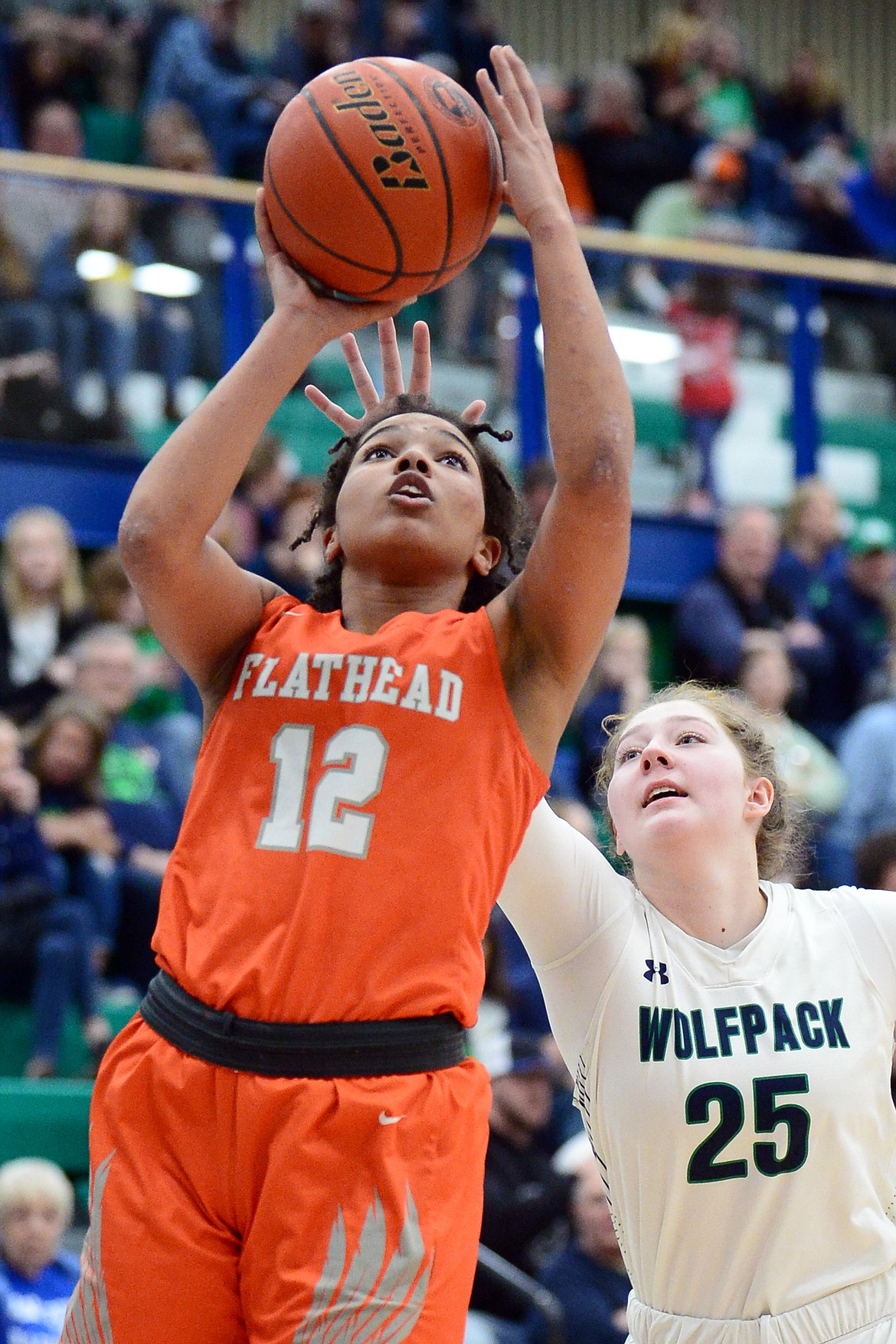 Flathead's Akilah Kubi (12) drives to the hoop against Glacier's Emma Anderson (25) during a crosstown matchup at Glacier High School on Friday. (Casey Kreider/Daily Inter Lake)