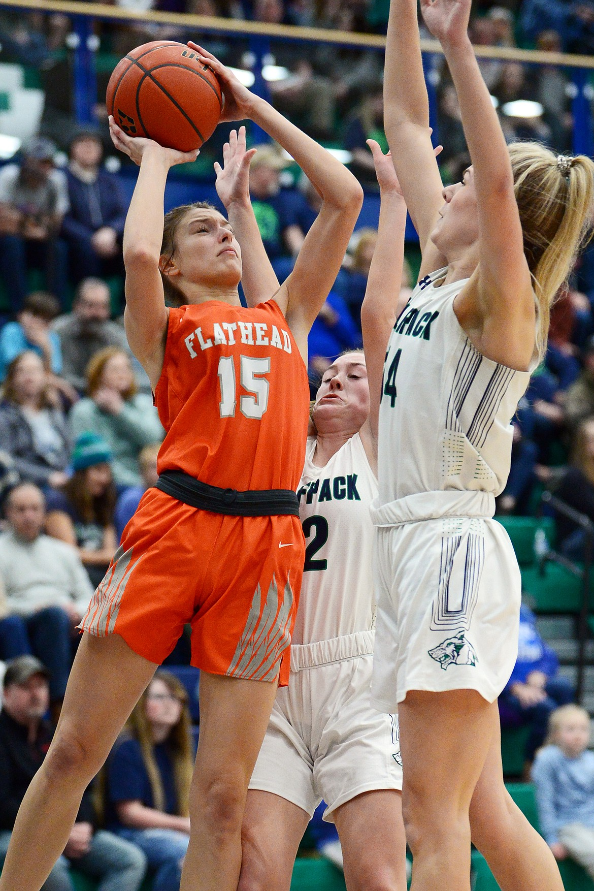 Flathead's Clare Converse (15) looks to shoot against Glacier's Kenzie Williams (12) and Aubrie Rademacher (14) during a crosstown matchup at Glacier High School on Friday. (Casey Kreider/Daily Inter Lake)