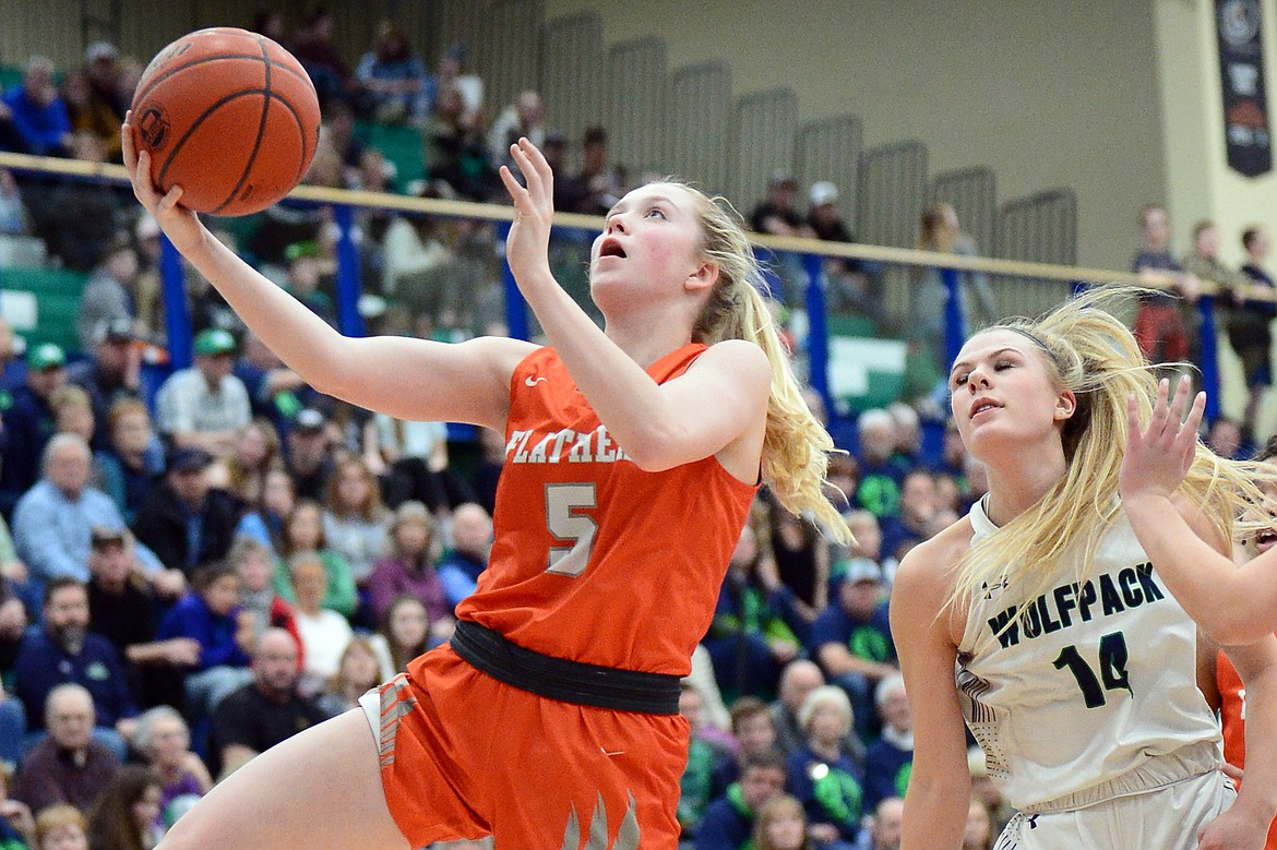 Flathead's Maddy Moy (5) drives to the hoop against Glacier during a crosstown matchup at Glacier High School on Friday. (Casey Kreider/Daily Inter Lake)