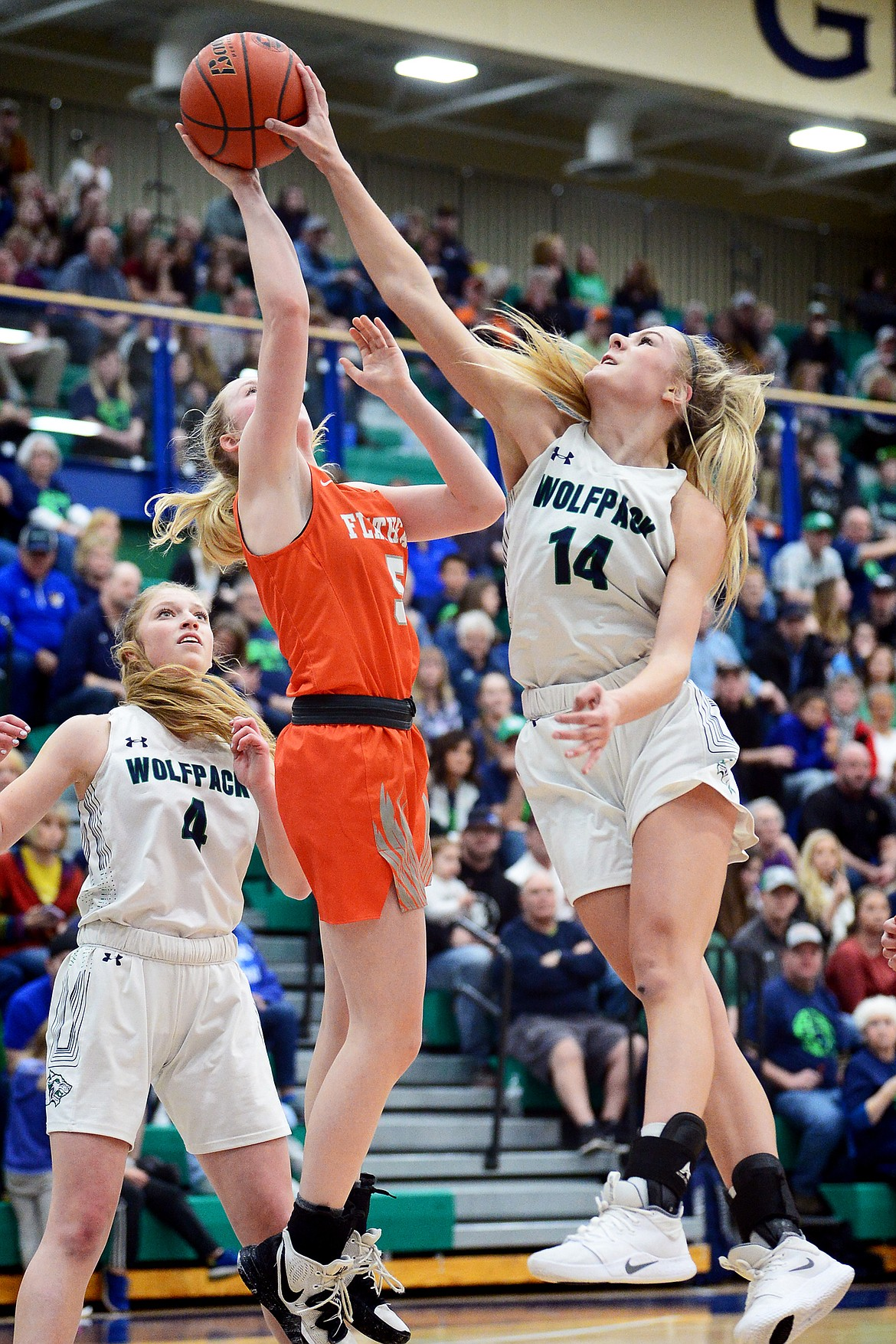 Glacier's Aubrie Rademacher (14) blocks the shot of Flathead's Maddy Moy (5) during a crosstown matchup at Glacier High School on Friday. (Casey Kreider/Daily Inter Lake)