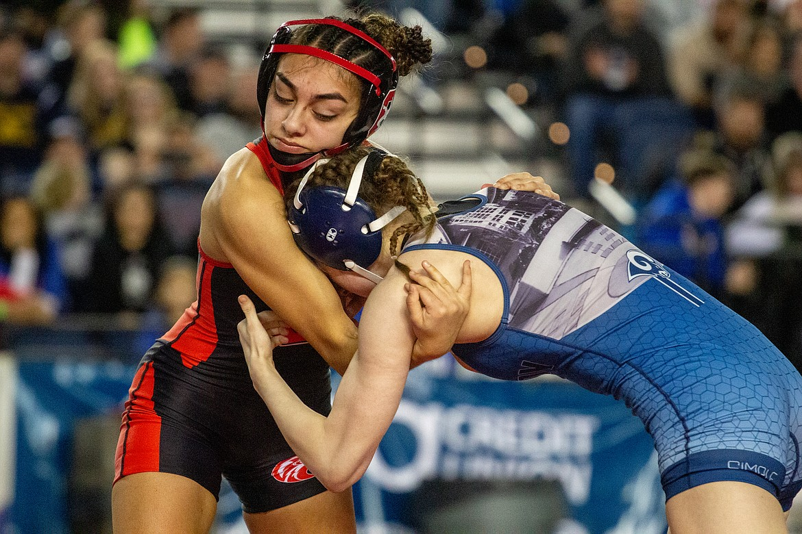 Casey McCarthy/Columbia Basin Herald Othello's Emily Mendez maintains control of her opponent, Salyna Shotwell as she went on to claim her first state title in her senior season on Saturday.