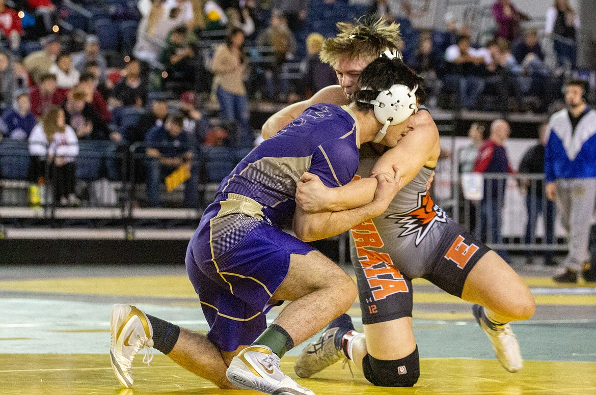 Casey McCarthy/Columbia Basin Herald Ephrata's Mac Laird works to overpower his opponent in the finals matchup at 195 in 2A on Saturday.