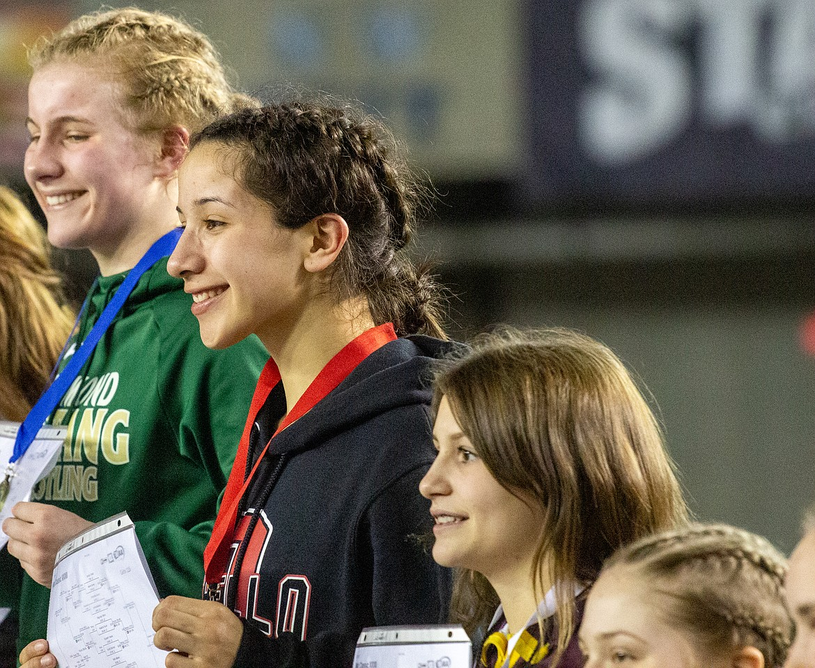 Casey McCarthy/Columbia Basin Herald Othello's Iyazely Barraza (second from left) and Moses Lake's Bianca Johnson (right) both found the podium on Saturday in Tacoma in the 115 pound division.