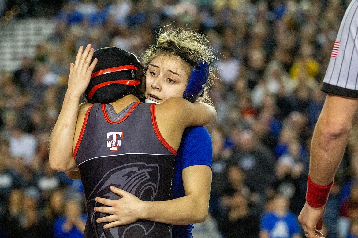 Casey McCarthy/Columbia Basin Herald Warden's Aaliyah Escamilla and Isabella Morales embrace after their final matchup on Saturday for the title at 105 at the Mat Classic.