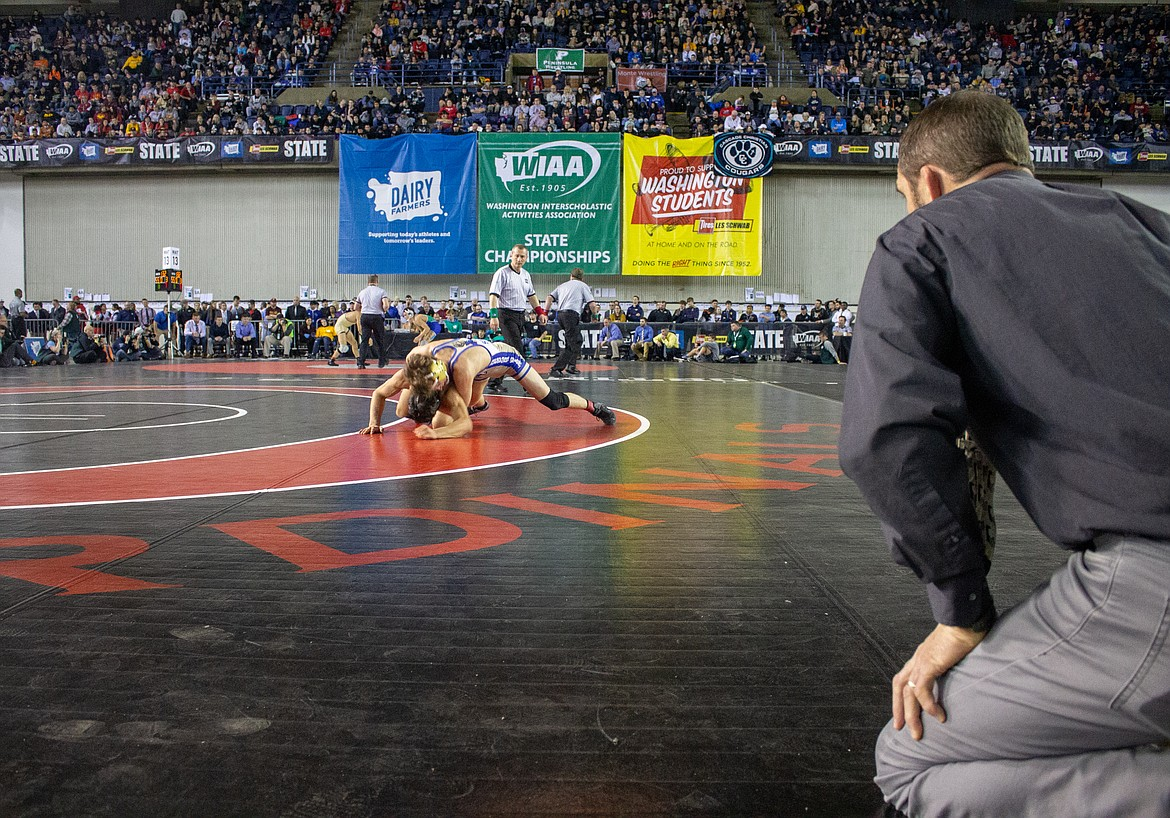Casey McCarthy/Columbia Basin Herald Royal head coach Ben Orth watches his senior, Lorenzo Myrick, in the finals on Saturday in the Mat Classic.