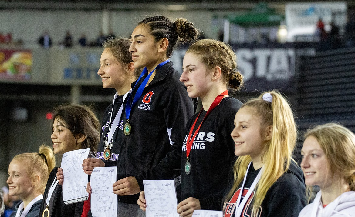 Casey McCarthy/Columbia Basin Herald Othello's Emily Mendez (top of podium) took first at 110, while fellow Huskie Alexis Monday (second from right) placed fourth in the same division.