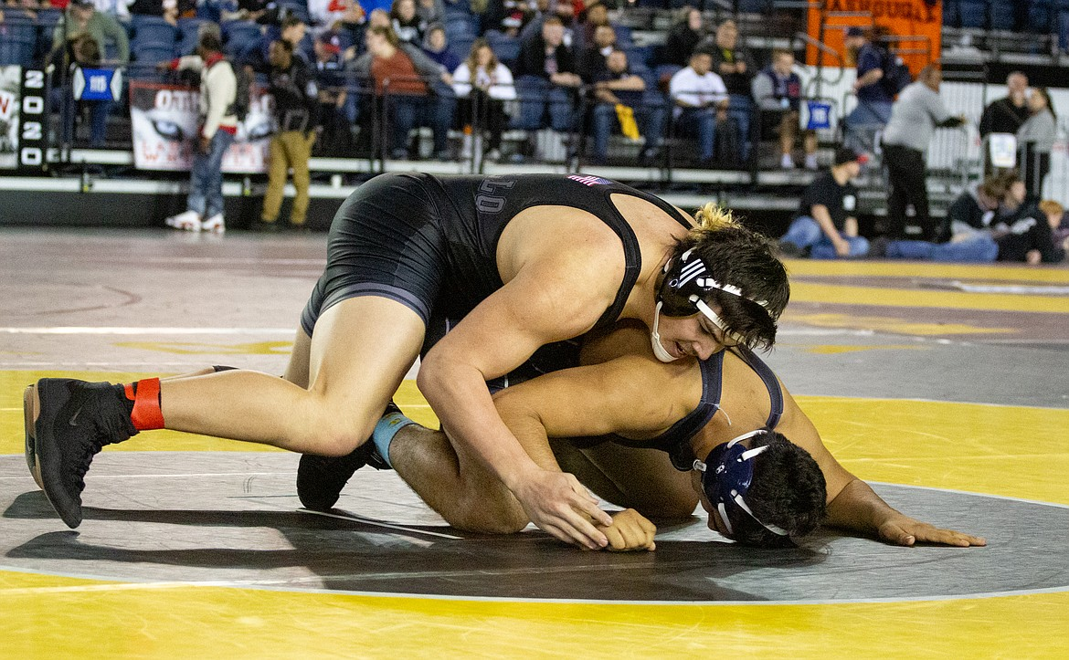 Casey McCarthy/Columbia Basin Herald Othello's Isaiah Perez was dominant in his final bout on the mat for the Huskies, walking away the first three-time state champion in the program's history.