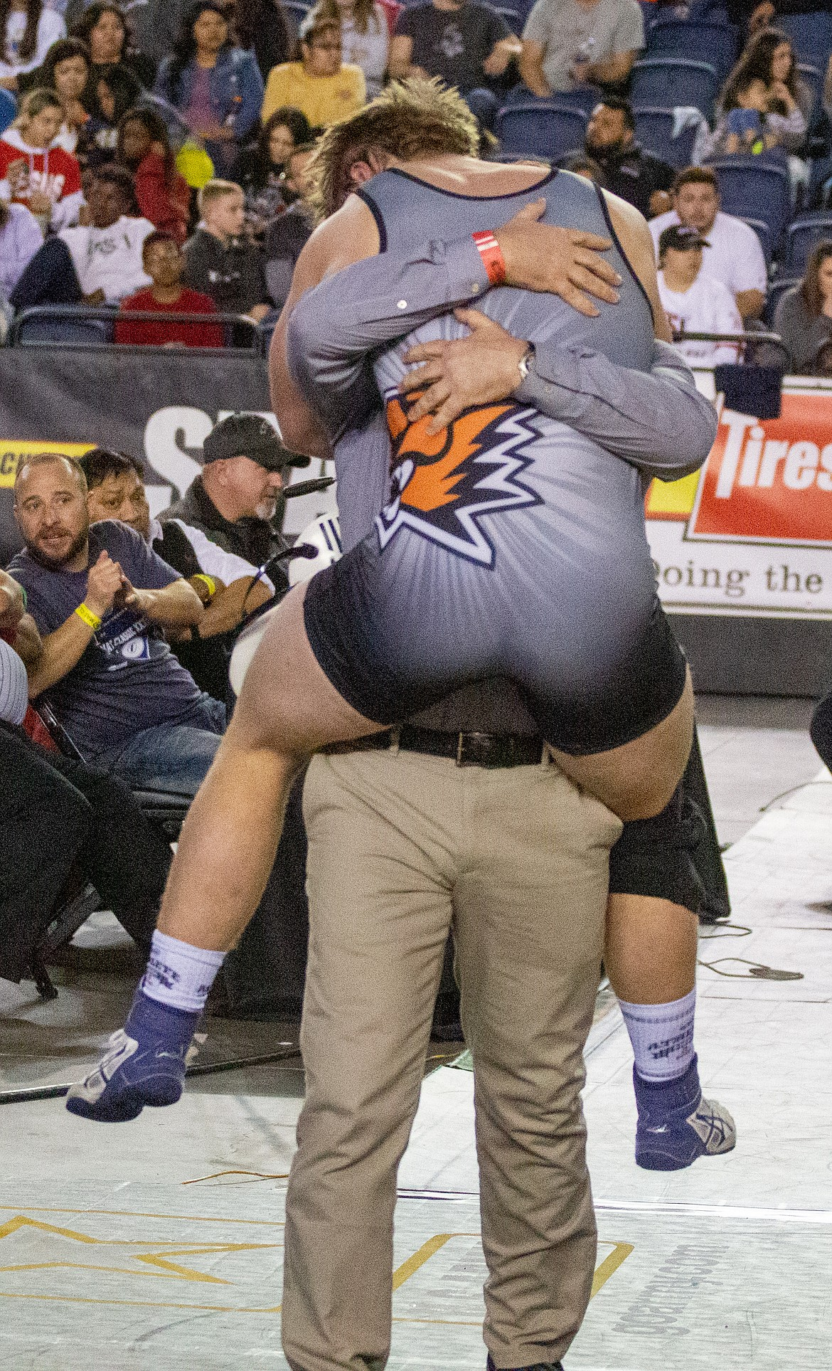Casey McCarthy/Columbia Basin Herald Ephrata assistant coach David Laird holds his son, senior Mac Laird, up after he claimed his first state title in his final bout for the Tigers, capping off the u