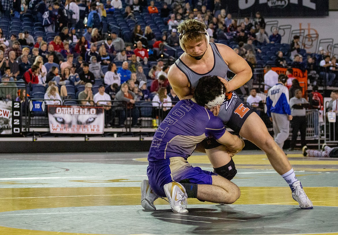 Casey McCarthy/Columbia Basin Herald Ephrata's Mac Laird grounds himself against North Kitsap's Nouh Hammou as the senior Tiger went on to claim his first title after finishing second in 2019.
