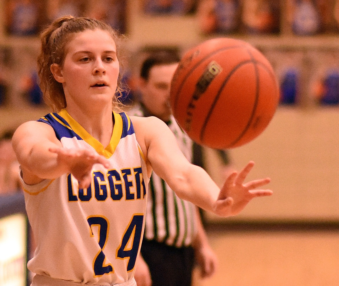 Elise Erickson of the Libby Lady Loggers passes the ball during a Feb. 21 home game against Whitefish. (Duncan Adams/The Western News)