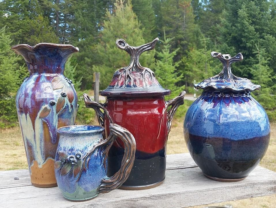 A selection of Mountain Brook Studio's pottery, including a huckleberry mug and vase.