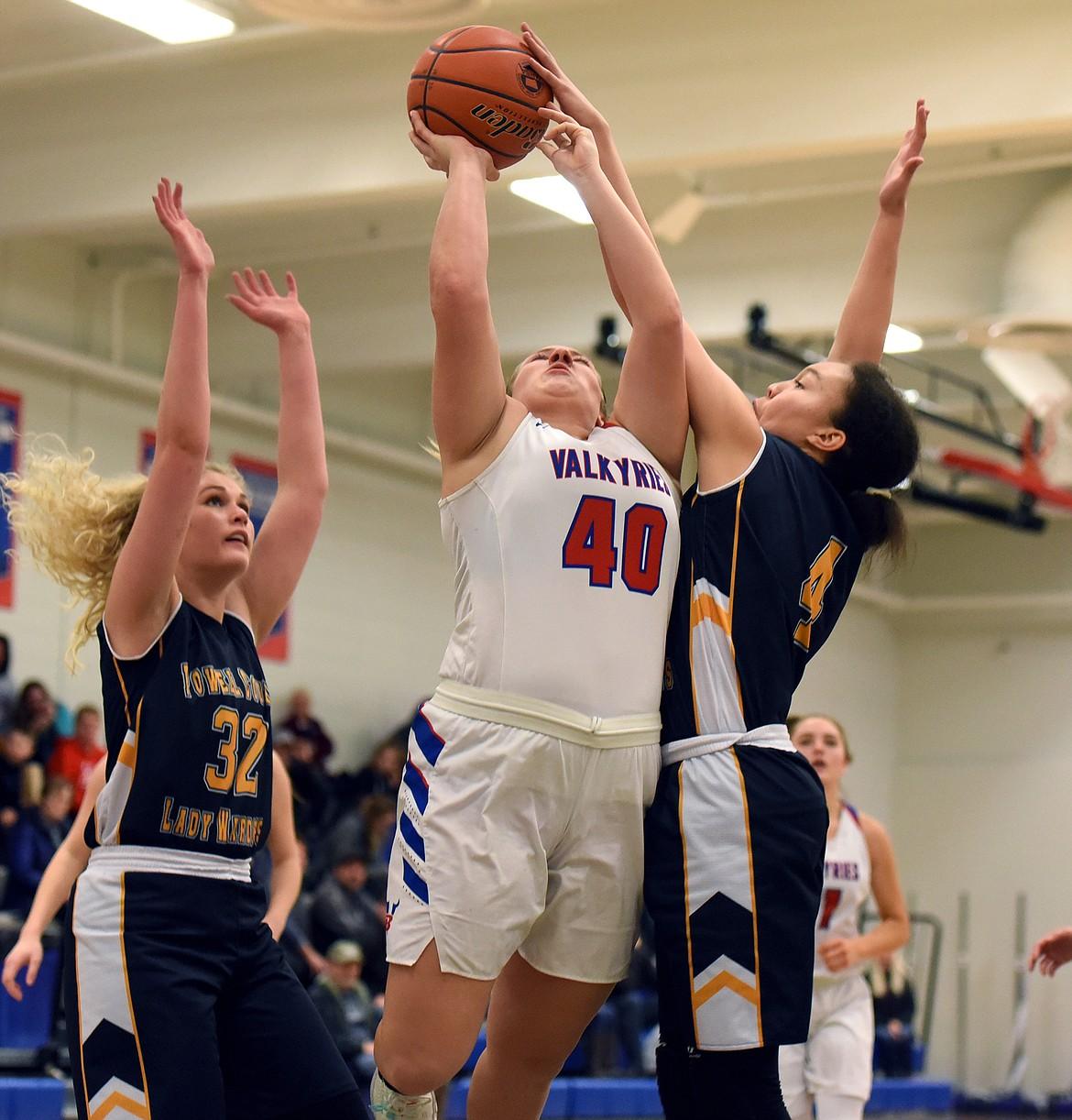Ashton McAnally battles Deer Lodge's Nia McClanahan for a rebound. (JEREMY WEBER/Bigfork Eagle)