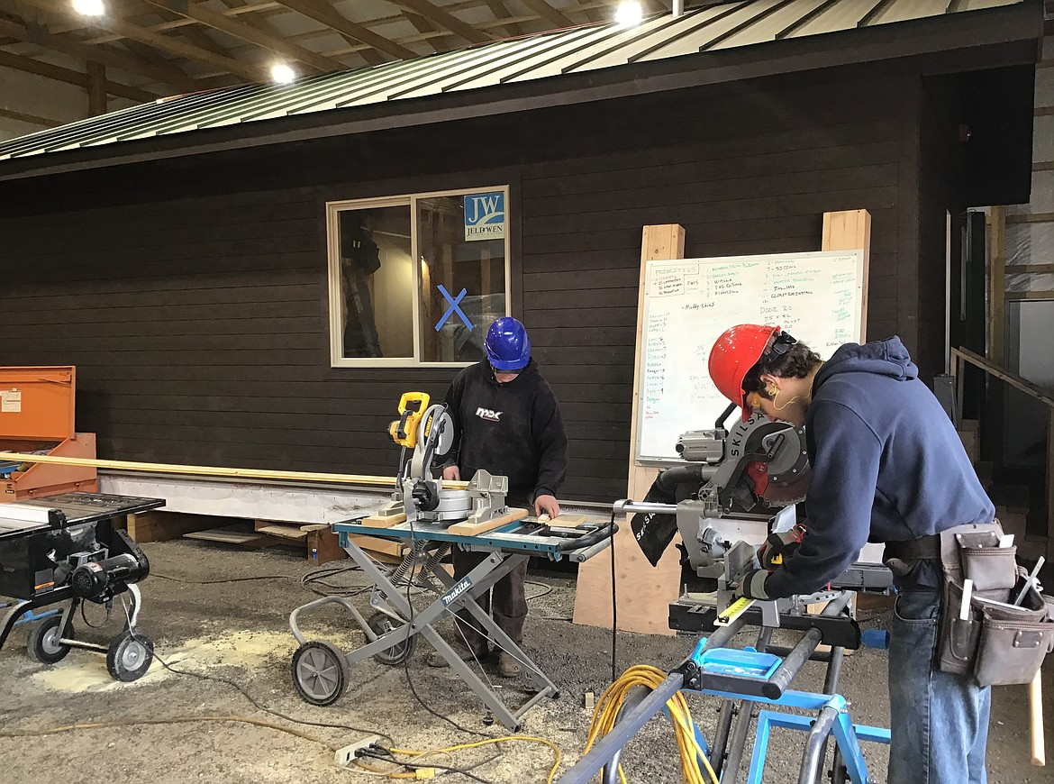 Columbia Falls students in the Building Trades pre-apprenticeship program work on a cabin destined for Polebridge. (Courtesy photo)