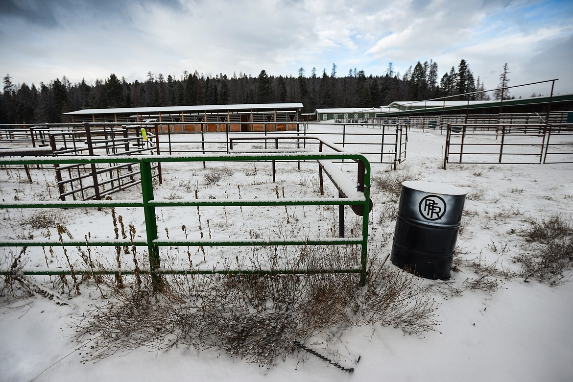 """The letters """"PFR"""" are stenciled on a barrel inside an enclosure at the site of the Potter's Field Ranch and Whitefish Equestrian Center on Friday, April 3. (Casey Kreider/Daily Inter Lake)"""