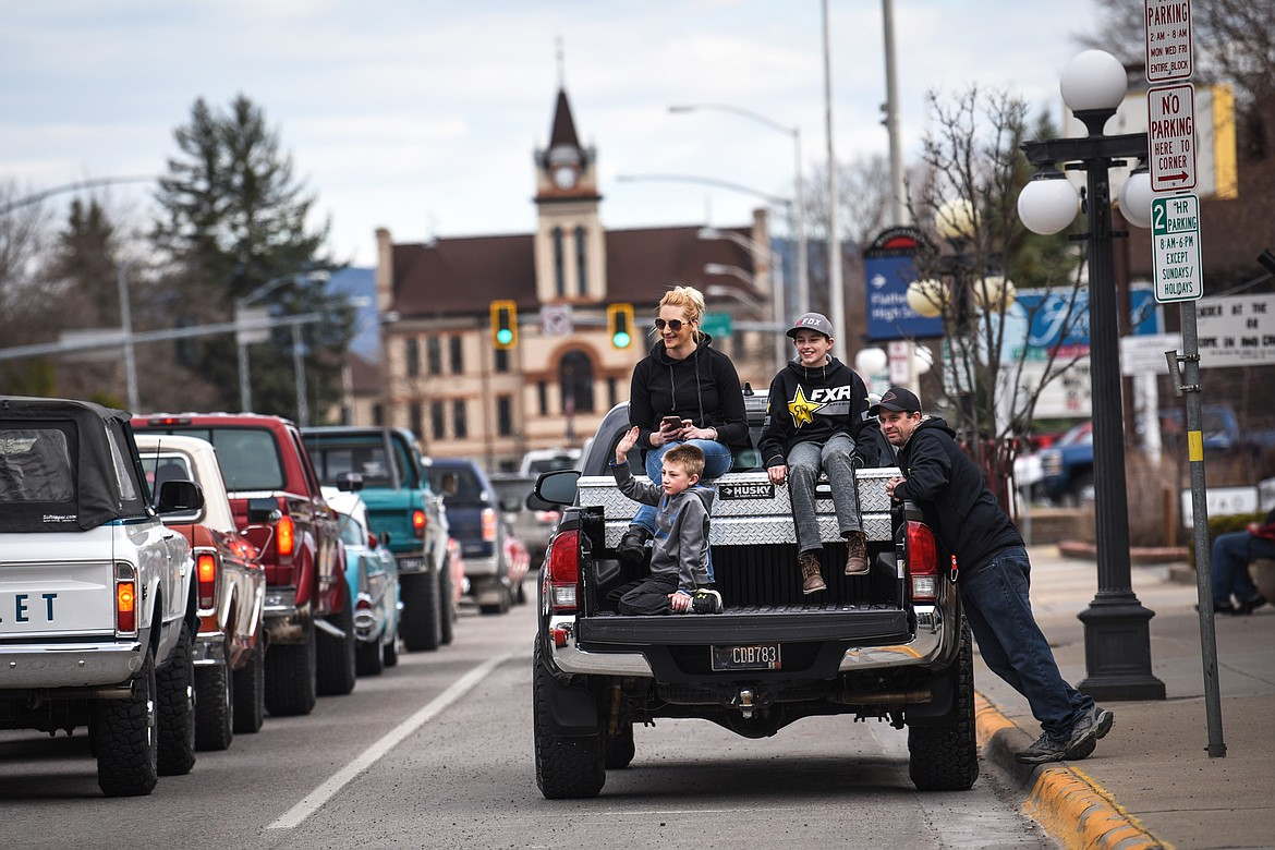 A family watches as cars and trucks make their way down Main Street during a Kruise Kalispell event on Friday, April 17. (Casey Kreider/Daily Inter Lake)