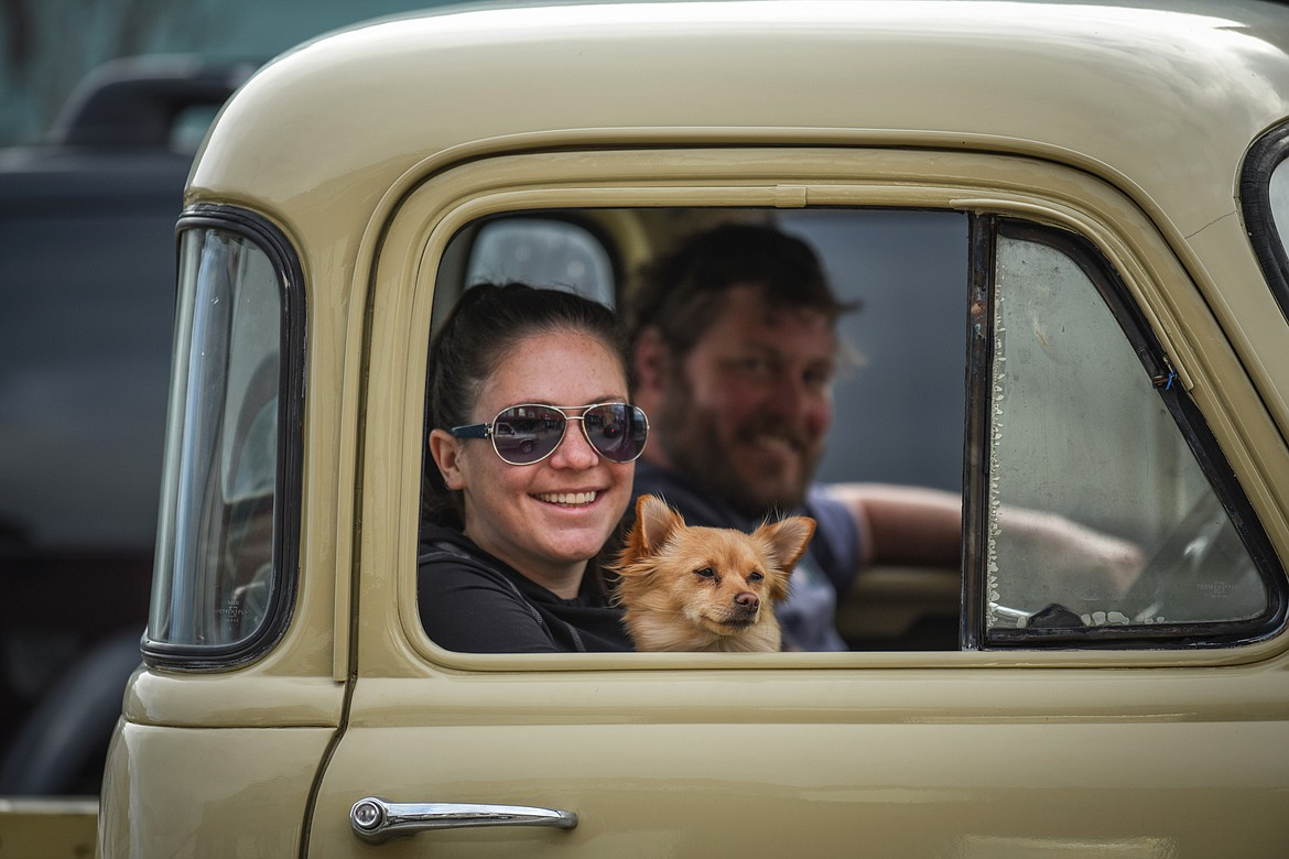 Passengers in a classic truck smile as they drive through the Kruise Kalispell event on Main Street on Friday, April 17. (Casey Kreider/Daily Inter Lake)