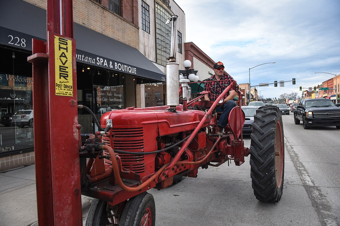 Tim Viano drove his 1947 Farmall International tractor from West Valley to participate in the Kruise Kalispell event on Main Street on Friday, April 17. (Casey Kreider/Daily Inter Lake)