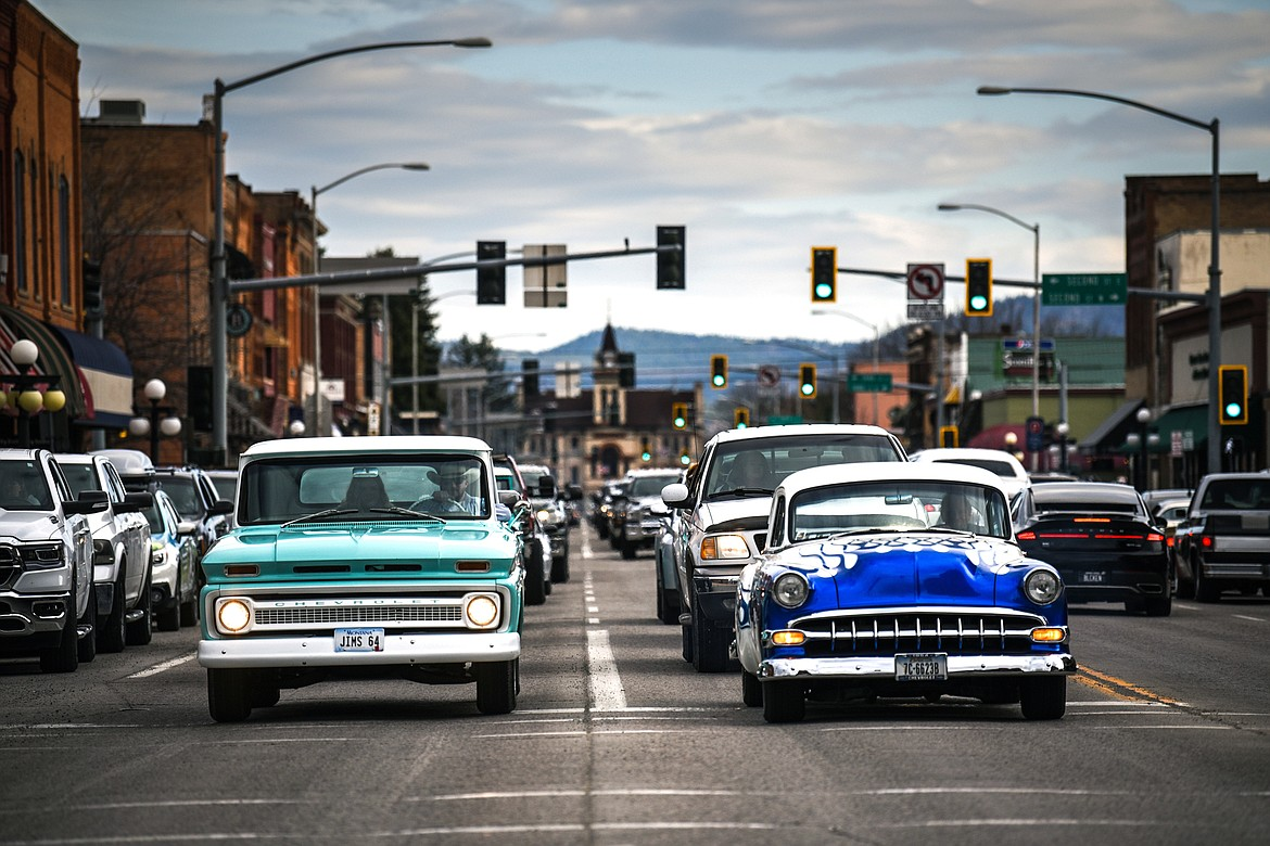 Vehicles stop at a traffic light on Main Street during the Kruise Kalispell event on Friday, April 17. (Casey Kreider/Daily Inter Lake)
