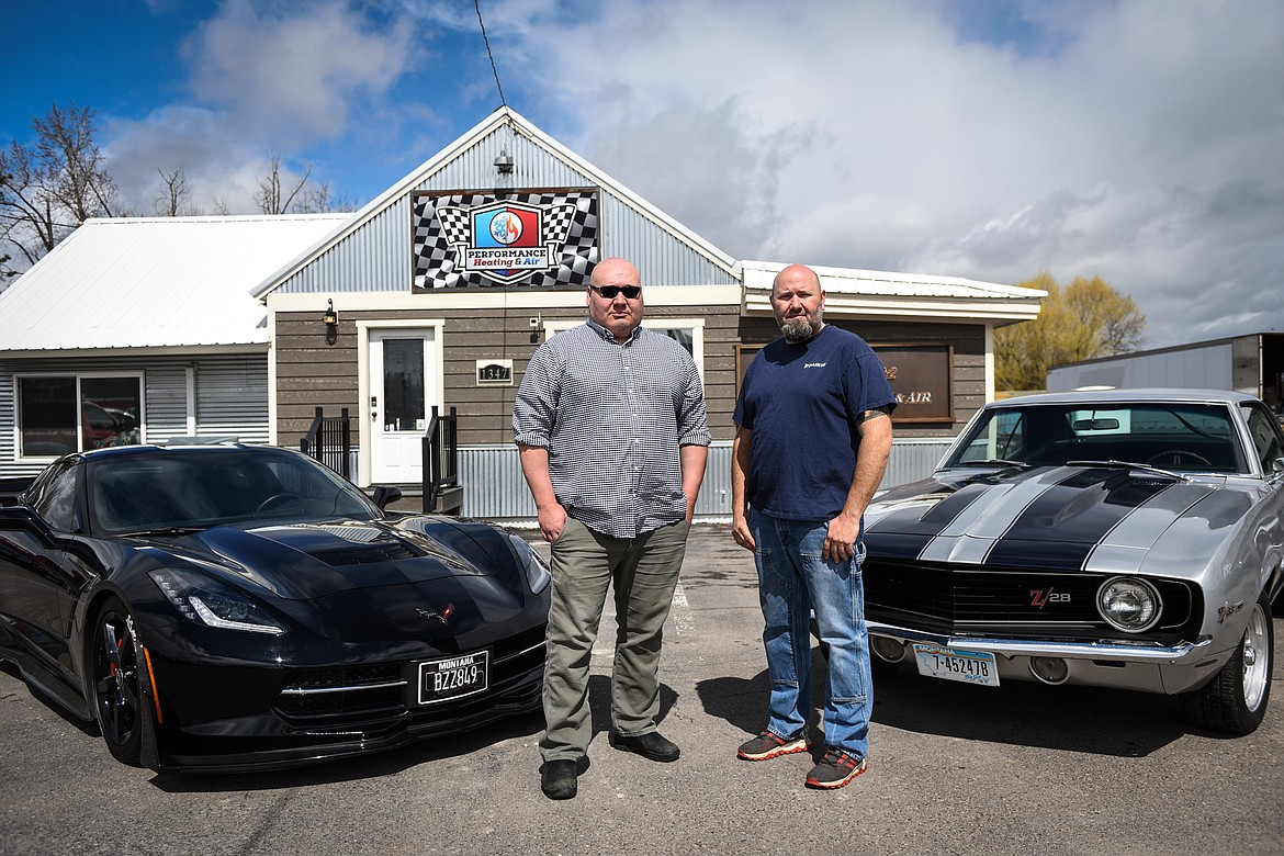 Monte Klindt, left, with his 2015 Chevrolet Corvette Stingray, and Jeremy Reese, right, with his 1969 Chevrolet Camaro Z28, outside the business they co-own, Performance Heating & Air in Evergreen on Thursday, April 23.