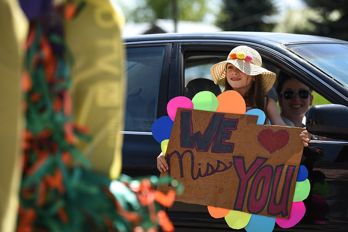 Leyna Marcus, a kindergartener at Swan River School, holds a sign during a Cinco de Mayo Parade for teachers, students and staff outside the school in Bigfork on Tuesday. (Casey Kreider/Daily Inter Lake)