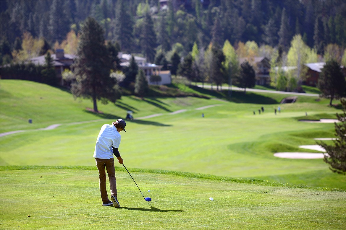 Bigfork's Asher VanCampen tees off on the 13th hole at Eagle Bend Golf Club on Tuesday. (Casey Kreider/Daily Inter Lake)