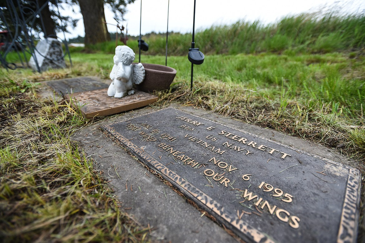 The gravestone of Jerry E. Sterrett, a U.S. Navy veteran of the Vietnam War, is shown at Lone Pine Cemetery in Bigfork on Friday, May 15. (Casey Kreider/Daily Inter Lake)