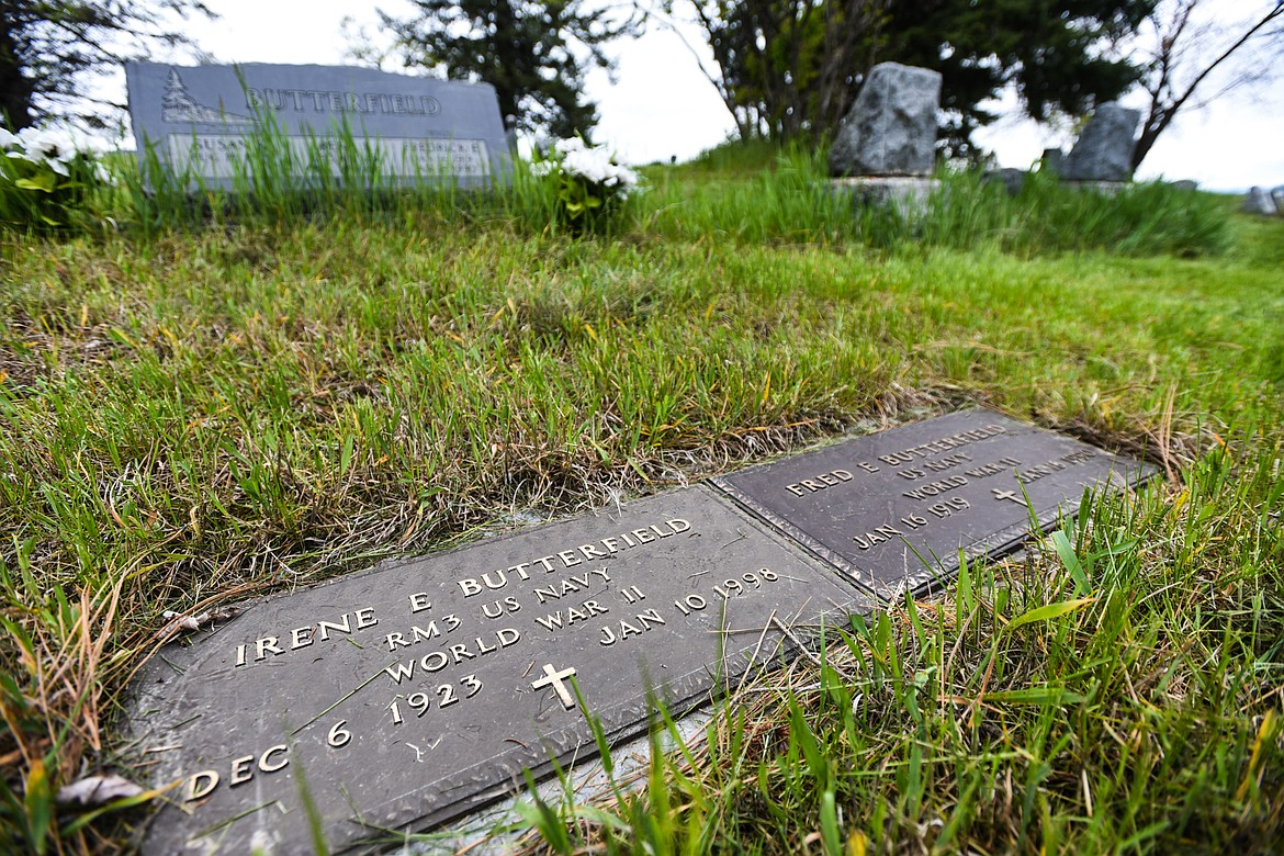 The gravestones of Irene E. and Fred E. Butterfield, U.S. Navy veterans of World War II and husband and wife, at Lone Pine Cemetery in Bigfork on Friday, May 15. (Casey Kreider/Daily Inter Lake)