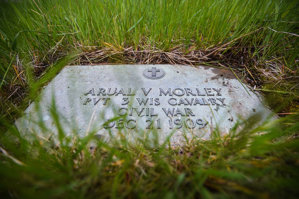 The gravestone of Arual V. Morley, a U.S. Army veteran of the Civil War, at Lone Pine Cemetery in Bigfork on Friday, May 15. (Casey Kreider/Daily Inter Lake)