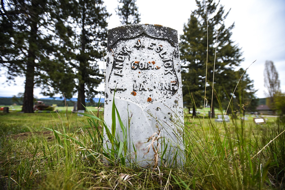 The gravestone of Andrew J. Eslick, a U.S. Army veteran of the Civil War, at Lone Pine Cemetery in Bigfork on Friday, May 15.