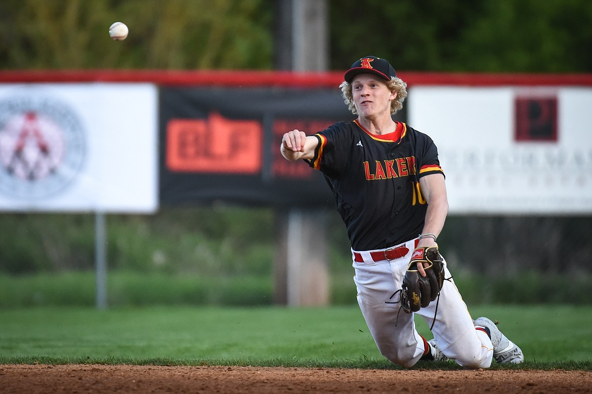 Kalispell Lakers AA shortstop Connor Drish throws to first from his knees after fielding a grounder against the Glacier Twins A at Griffin Field on Saturday. (Casey Kreider/Daily Inter Lake)