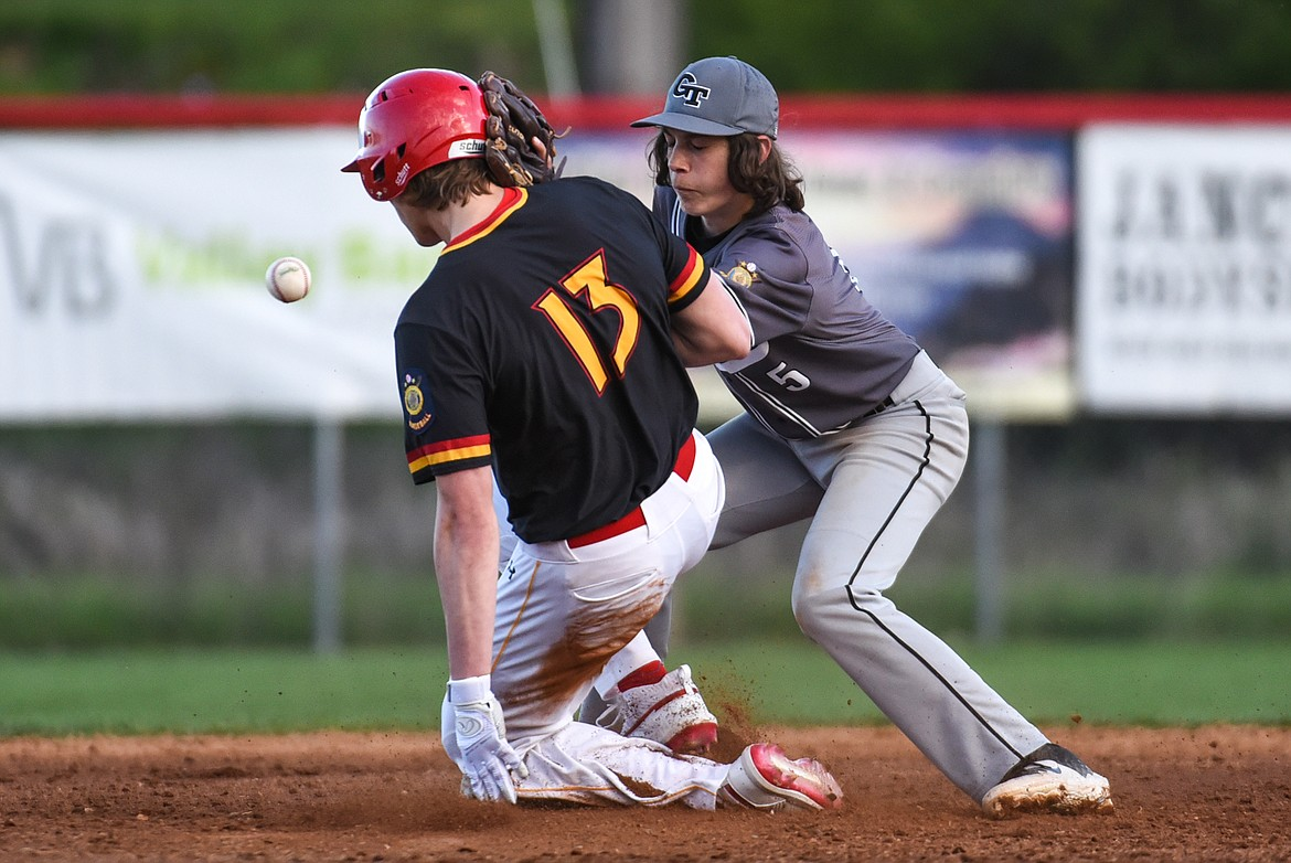 Kalispell Lakers AA's Ethan Diede steals second base ahead of the throw down to Glacier Twins A second baseman George Robbins at Griffin Field on Saturday. (Casey Kreider/Daily Inter Lake)