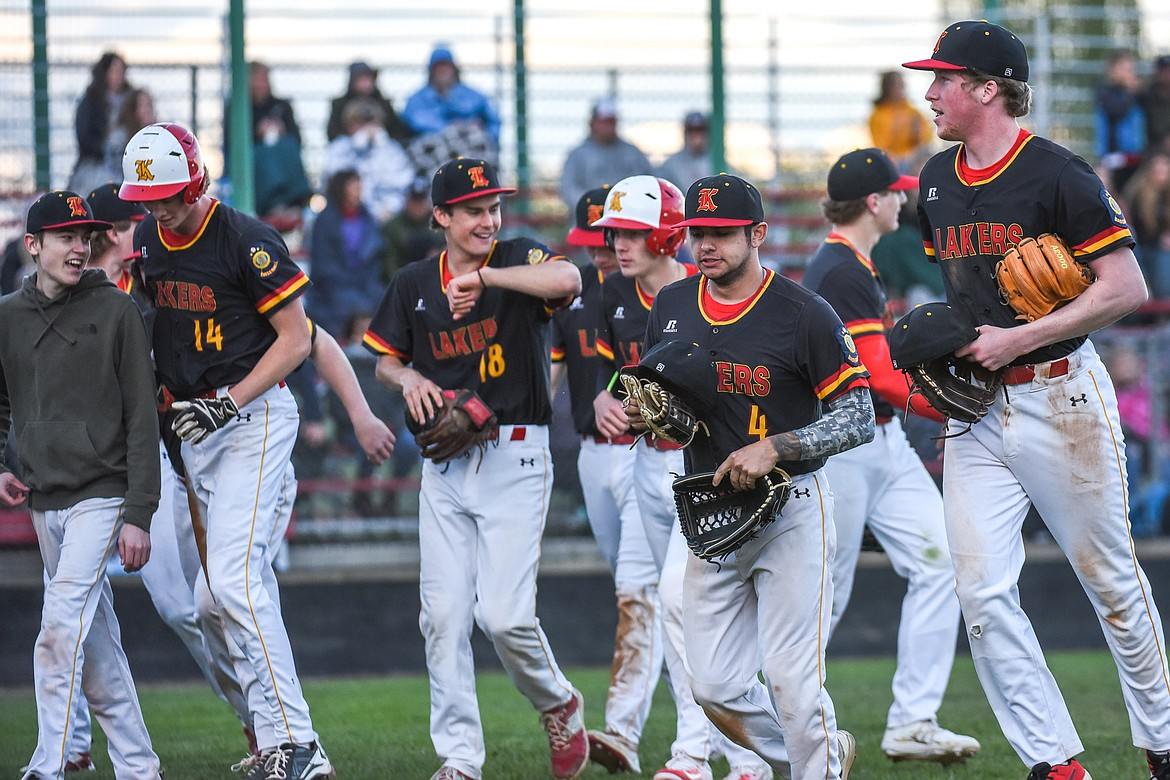 Kalispell celebrates after scoring a run in the bottom of the fifth  against the Glacier Twins A at Griffin Field on Saturday. (Casey Kreider/Daily Inter Lake)