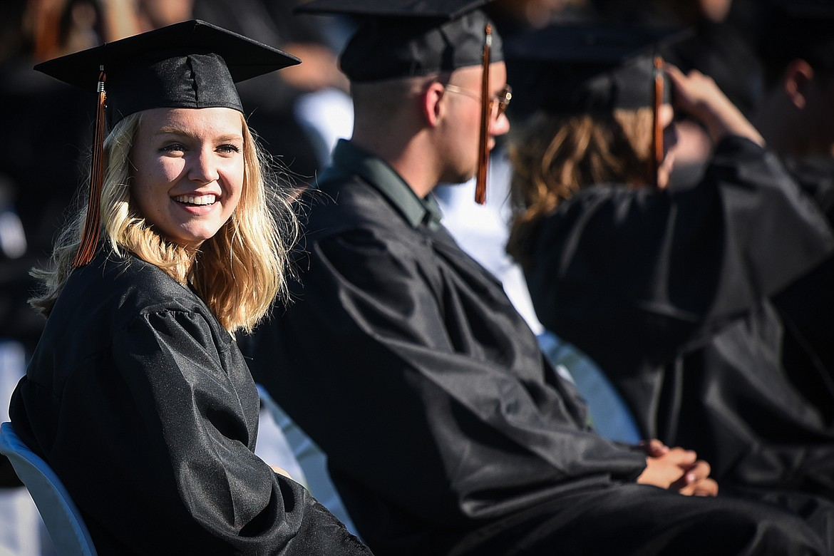 A graduate smiles during the Flathead High School Class of 2020 commencement ceremony at Legends Stadium on Friday, May 29. (Casey Kreider/Daily Inter Lake)