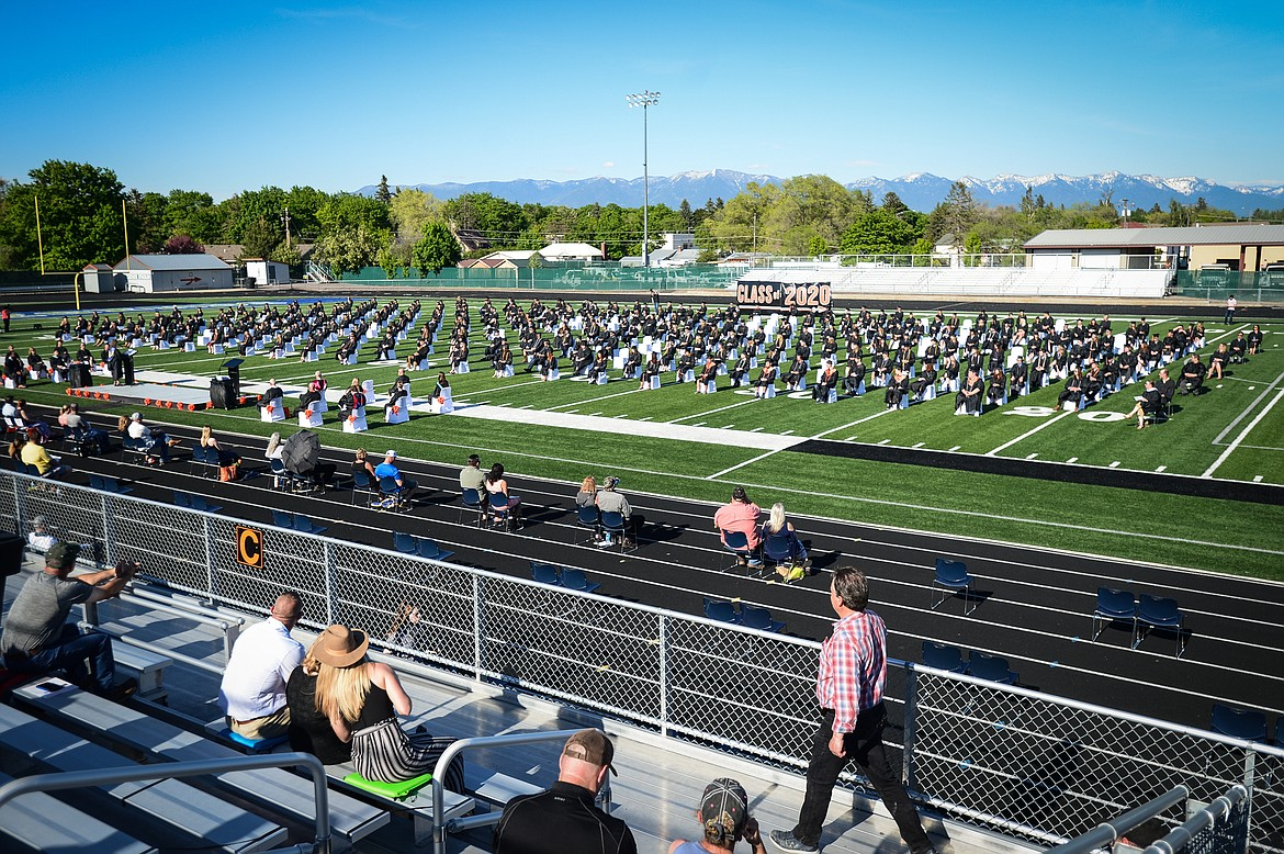 Graduates take their seats on the turf at Legends Stadium during the Flathead High School Class of 2020 commencement ceremony on Friday, May 29. (Casey Kreider/Daily Inter Lake)